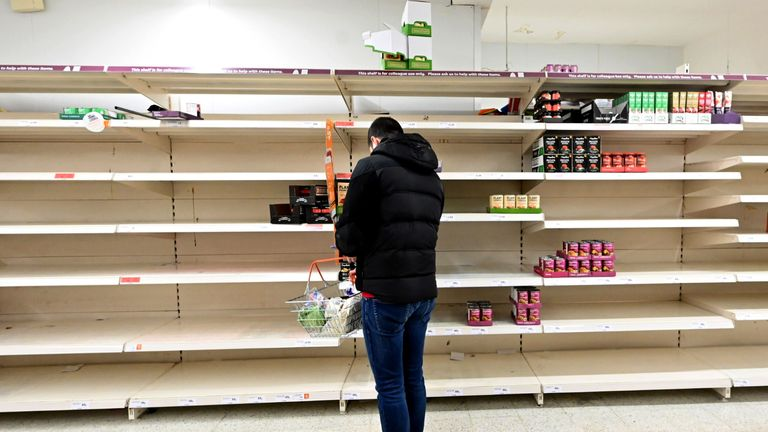 Shoppers are faced with partially empty shelves at a supermarket in London on March 14, 2020, as consumers worry about product shortages, leading to the stockpiling of household products due to the outbreak of the novel coronavirus COVID-19. - British Prime Minister Boris Johnson, who has faced criticism for his country's light touch approach to tackling the coronavirus outbreak, is preparing to review its approach and ban mass gatherings, according to government sources Saturday. (Photo by JUSTIN TALLIS / AFP) (Photo by JUSTIN TALLIS/AFP via Getty Images)