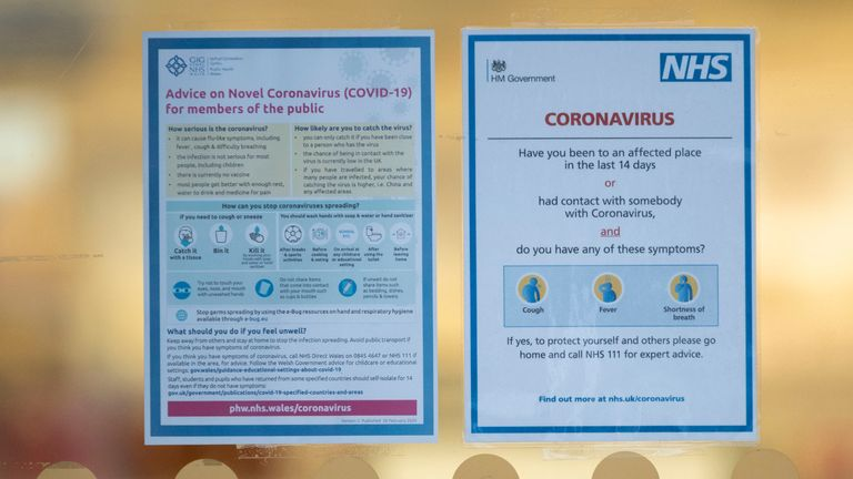 CARDIFF, UNITED KINGDOM - MARCH 08: An NHS sign warning of the symptoms of coronavirus in a shop window on March 8, 2020 in Cardiff, United Kingdom. Coronavirus (Covid-19) has spread to over 100 countries in a matter of weeks, claiming over 3,800 lives and infecting over 109,000. There are currently 273 diagnosed cases in the UK and two deaths. (Photo by Matthew Horwood/Getty Images)