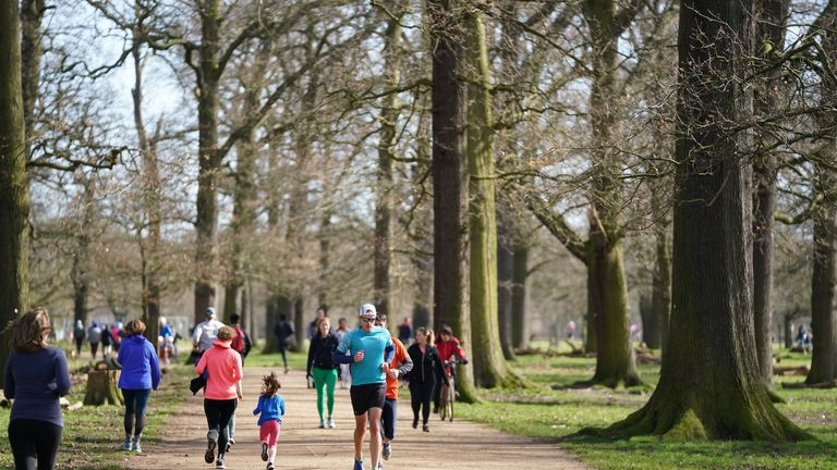 Runners and cyclists in Richmond Park on the second day of the Astronomical Spring which began on the day of the Spring Equinox. PA Photo. Picture date: Saturday March 21, 2020. See PA story WEATHER Spring. Photo credit should read: John Walton/PA Wire