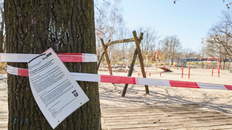 BERLIN, GERMANY - MARCH 23: An official paper informs parents not to use the playground in Berlin Kreuzberg due to the new contact restrictions because of covid-19 on March 23rd in BERLIN, Germany. The coronavirus and the disease it causes, covid-19, are having a fundamental impact on society, government and the economy in Germany. Public life has been restricted to the essentials in an effort by authorities to slow the spread of infections. Hospitals are scrambling to increase their testing and care capacity. An economic recession seems likely as economic activity is slowed and many businesses are temporarily closed. Schools, daycare centers and universities remain shuttered. And government, both federal and state, seek to mobilize resources and find adequate policies to confront the virus and mitigate its impact. (Photo by Sebastian Reuter/Getty Images)