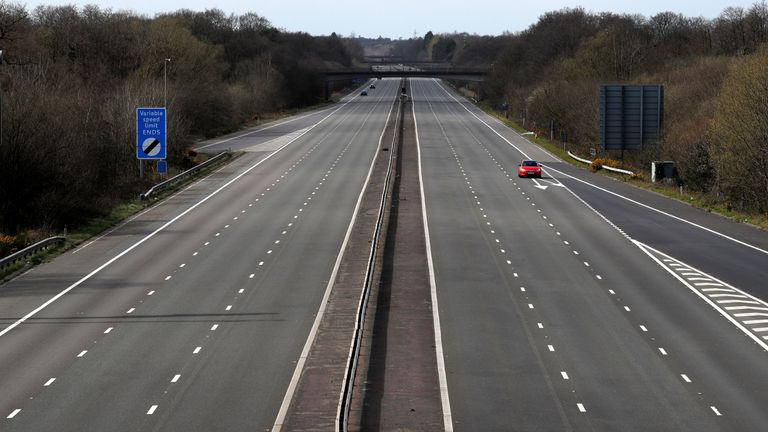 "A car travels along the almost deserted M3 motorway near Fleet, south west of London on March 29, 2020, as life in Britain continues during the nationwide lockdown to combat the novel coronavirus pandemic. - Prime Minister Boris Johnson warned Saturday the coronavirus outbreak will get worse before it gets better, as the number of deaths in Britain rose 260 in one day to over 1,000. The Conservative leader, who himself tested positive for COVID-19 this week, issued the warning in a leaflet being sent to all UK households explaining how their actions can help limit the spread. ""We know things will get worse before they get better,"" Johnson wrote. (Photo by Adrian DENNIS / AFP) (Photo by ADRIAN DENNIS/AFP via Getty Images)"