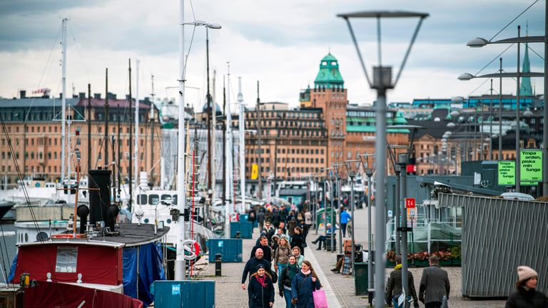People walk at Strandvagen in Stockholm on March 28, 2020, during the the new coronavirus COVID-19 pandemic. - Sweden, which has stayed open for business with a softer approach to curbing the COVID-19 spread than most of Europe, on March 27, 2020 limited gatherings to 50 people, down from 500. (Photo by Jonathan NACKSTRAND / AFP) (Photo by JONATHAN NACKSTRAND/AFP via Getty Images)