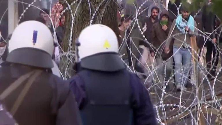Greek police clash with migrants at the border with Turkey