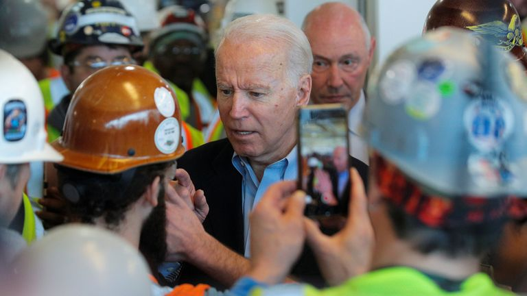 Democratic U.S. presidential candidate and former Vice President Joe Biden argues with a worker