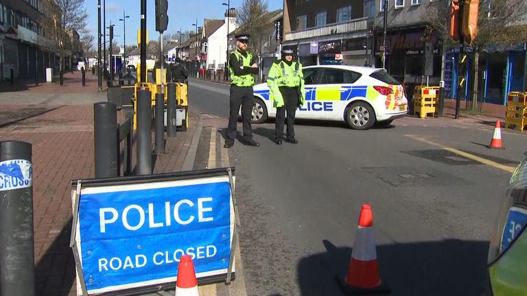Police have cordoned off the road in Luton