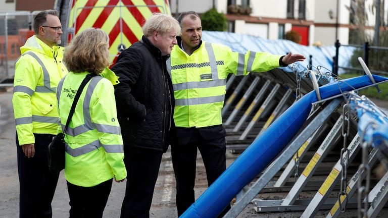 Britain's Prime Minister Boris Johnson visits Bewdley to see recovery efforts following recent flooding