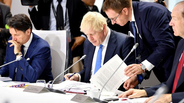 Giuseppe Conte (L) and Boris Johnson spoke over the phone on Friday. File pic