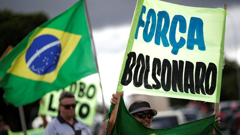 Supporters of far-right Brazilian President Jair Bolsonaro protest against the recommendations for social isolation in Brasilia, Brazil