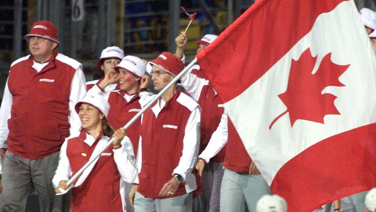Canada's Caroline Brunet carries her country's flag as she leads the Canadian team during the opening ceremony of the Sydney 2000 Olympic Games, September 15, 2000. Athletes from 199 nations are participating in the XXVII Summer Olympic Games which will continue until October 1.