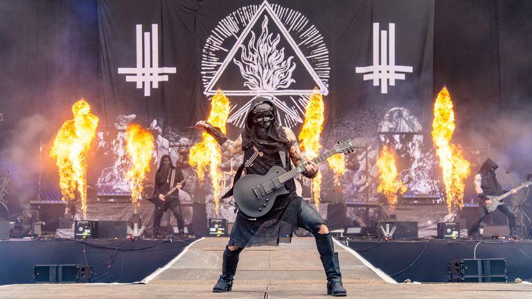 CASTLE DONINGTON, ENGLAND - JUNE 15: Adam Darski of Behemoth performs on stage during Download festival 2019 at Donington Park on June 14, 2019 in Castle Donington, England. (Photo by Joseph Okpako/WireImage)
