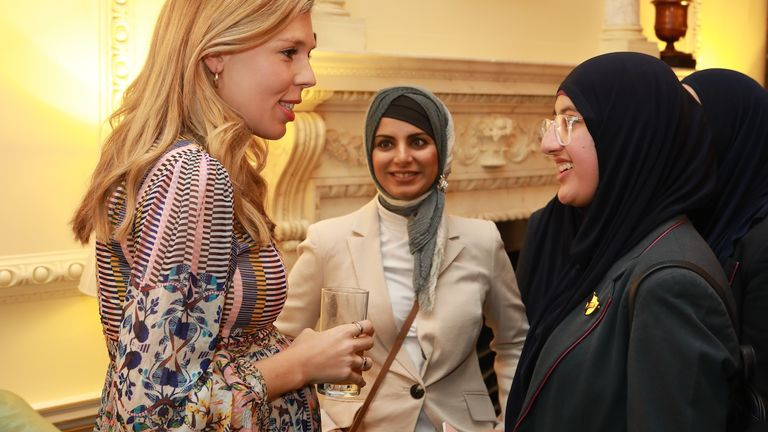 Boris Johnson's fiancee Carrie Symonds talks to women attending a Down Street event