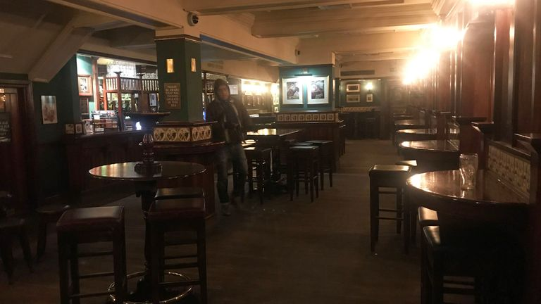 A solitary drinker in the Chando's pub at Charing Cross, London
