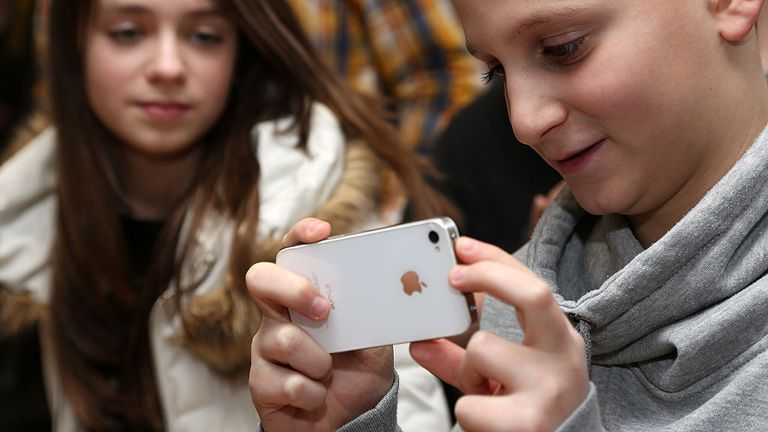 BERLIN, GERMANY - FEBRUARY 11: A student uses an Apple iPhone smartphone at the Friedensburg Oberschule (Friedensburg high school) during the tenth annual Safer Internet Day (SID) on February 11, 2014 in Berlin, Germany. Safer Internet Day (SID) is held internationally to promote safer and more responsible use of online technology and mobile phones, particularly amongst younger people. (Photo by Adam Berry/Getty Images)
