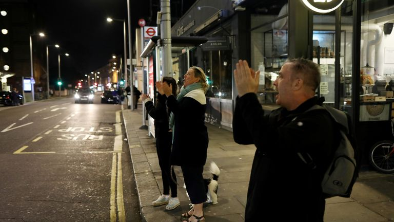 People on the streets outside Chelsea and Westminster Hospital applaud NHS workers during the Clap for our carers campaign in support of the NHS, as the spread of the coronavirus disease (COVID-19) continues, London, Britain, March 26, 2020