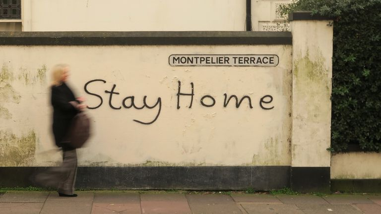 'Stay home' graffiti on a wall in Brighton