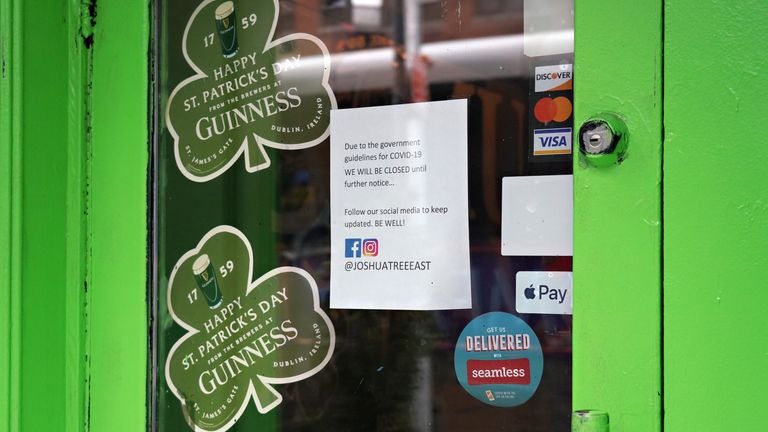 NEW YORK, NY - MARCH 16: A closure sign is posed alongside Happy St. Patricks Day decorations in the window of Joshua Tree Bar as the coronavirus continues to spread across the United States on March 16, 2020 in New York City. The World Health Organization declared coronavirus (COVID-19) a global pandemic on March 11th. (Photo by Cindy Ord/Getty Images)