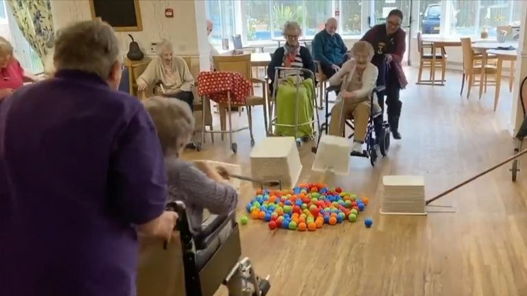Elderly residents of a care home in Wales enjoyed a makeshift game of Hungry Hippos while under lockdown