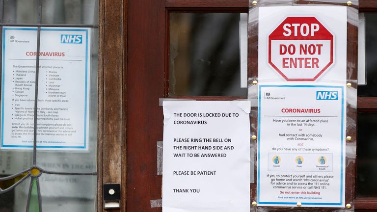 """A """"Do Not Enter sign"""" and National Health Service (NHS) information about the coronavirus is displayed at the entrance to a Doctors surgery in North London, Britain March 13, 2020. REUTERS/John Sibley"""