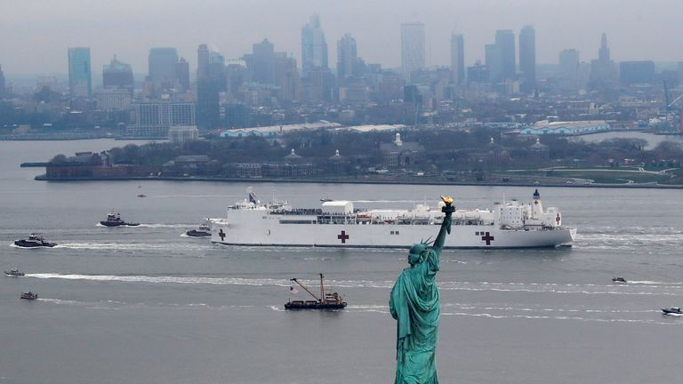 The USNS Comfort passes the Statue of Liberty as it enters New York Harbour during the outbreak of the coronavirus disease (COVID-19)