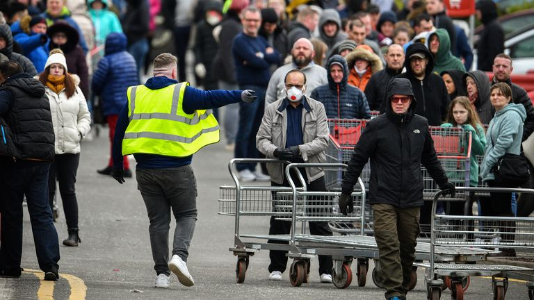 People queue outside the Costco wholesalers in Glasgow