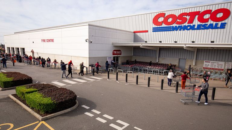 Hundreds of people queue to enter a Costco Wholesalers in Coventry on Saturday