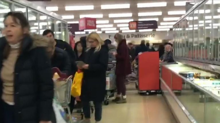 Queues at supermarkets stretch through aisles