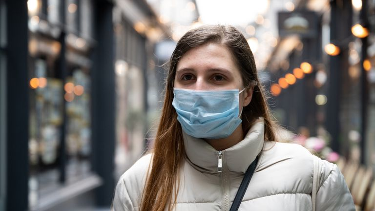 A women wears a face mask in Cardiff on March 17