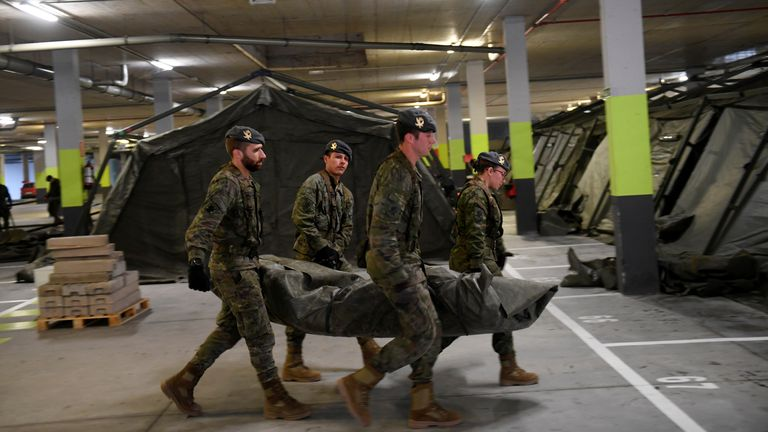 Spain's military install a tent hospital in the underground parking lot of a hospital in Oviedo