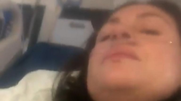 A video showing a hospitalized woman suffering from COVID-19 symptoms and urging viewers to be cautious regarding their health has gone viral.