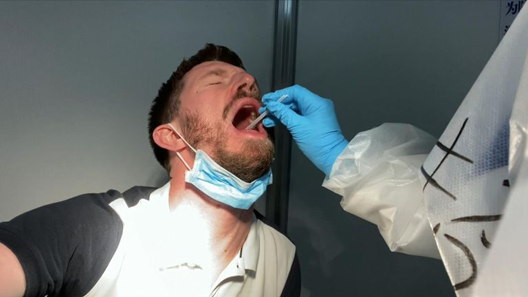 The test for COVID-19 included a swabat the back of the throat
