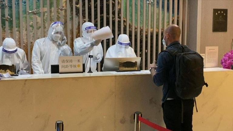 At the boarding gate, officials were wearing full personal protective equipment