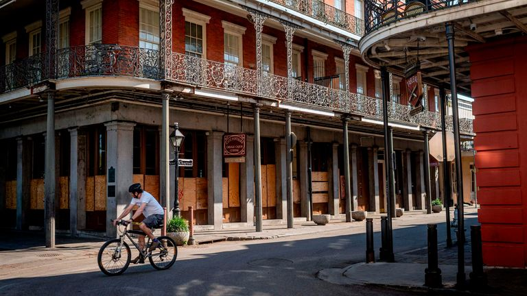 A man cycles along Jackson Square in New Orleans, Louisiana, on March 26, 2020