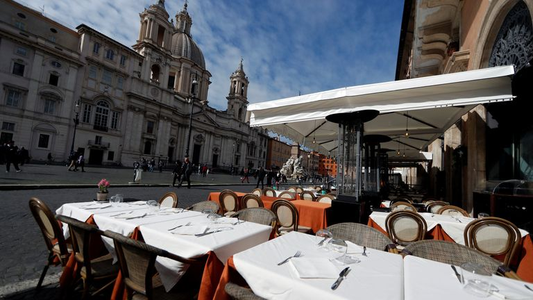 An empty restaurant is pictured at Piazza Navona square, after the government decree to close schools, cinemas, and urge people to work from home and not stand closer than one metre to each other in Rome, Italy, March 5, 2020. REUTERS/Yara Nardi