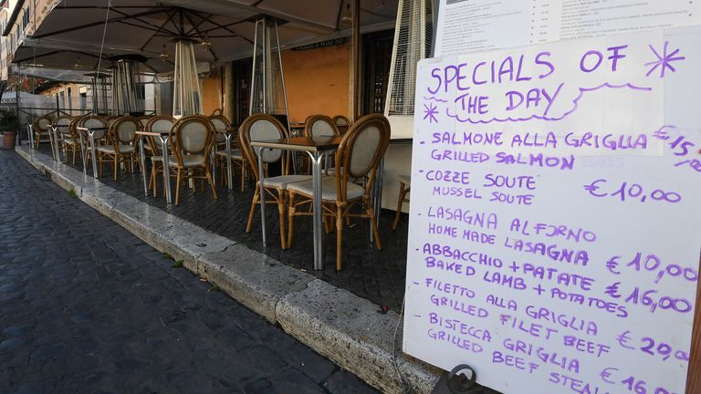 Closed bars and restaurants are pictured near Piazza Navona, on the third day of an unprecedented lockdown across of all Italy imposed to slow the outbreak of coronavirus, in Rome, Italy, March 12, 2020. REUTERS/Alberto Lingria