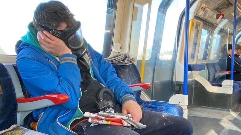 Coronavirus outbreak, London, UK - 06 Mar 2020 A man on the underground wearing a gas mask  6 Mar 2020