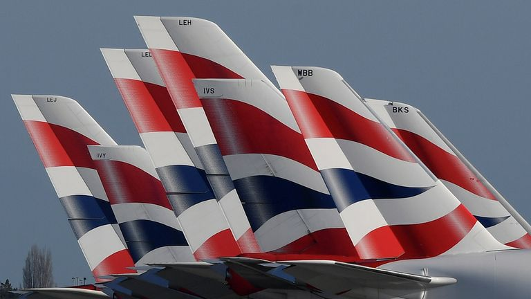 Tail Fins of British Airways planes are seen parked at Heathrow airport as the spread of the coronavirus disease (COVID-19) continues, London, Britain, March 31, 2020. REUTERS/Toby Melville