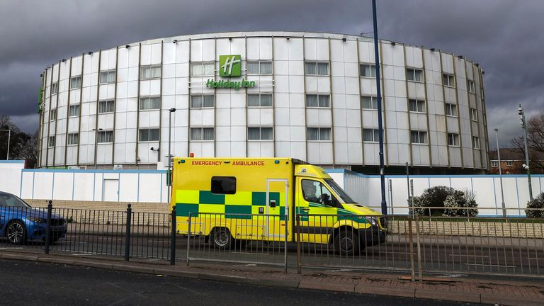 An ambulance passes the Holiday Inn hotel near Heathrow Airport in London, which has been reserved by the Government for people arriving from abroad to self-isolate. PA Photo. Picture date: Tuesday March 10, 2020. See PA story HEALTH Coronavirus. Photo credit should read: Steve Parsons/PA Wire