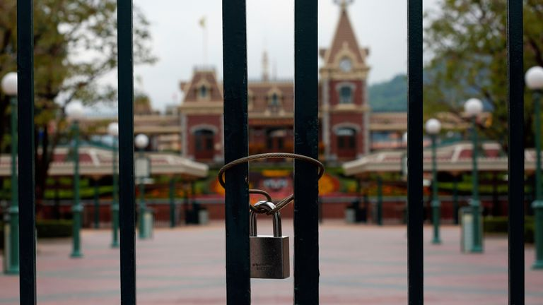 A locked gate is seen after the Hong Kong Disneyland theme park has been closed, following the coronavirus outbreak in Hong Kong, China January 26, 2020. REUTERS/Tyrone Siu