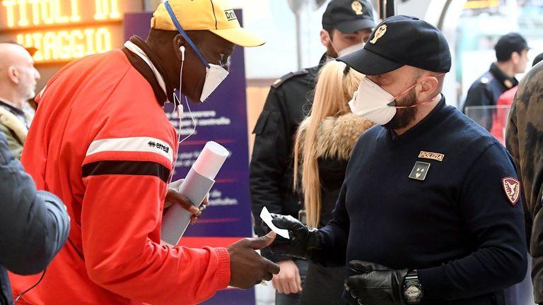 Police officers make checks at Milan's main train station