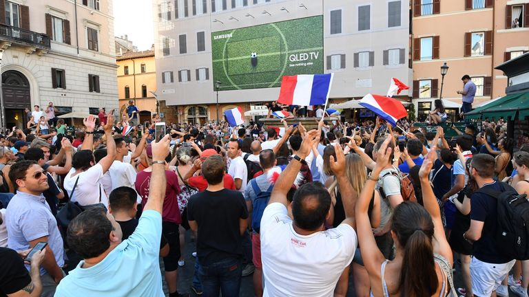 French supporters celebrate at the end of the Russia 2018 World Cup final football match between France and Croatia, on July 15, 2018 in the Campo di Fiori square, central Rome. (Photo by Andreas SOLARO / AFP) (Photo credit should read ANDREAS SOLARO/AFP via Getty Images)
