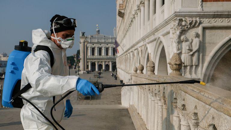 A worker sanitises Ponte della Paglia bridge in Venice, Italy