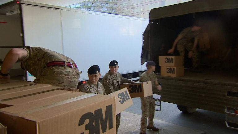 Troops help deliver protective equipment at St Thomas' Hospital in London
