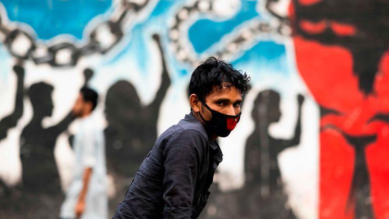A rickshaw driver wears a face mask in Bangladesh