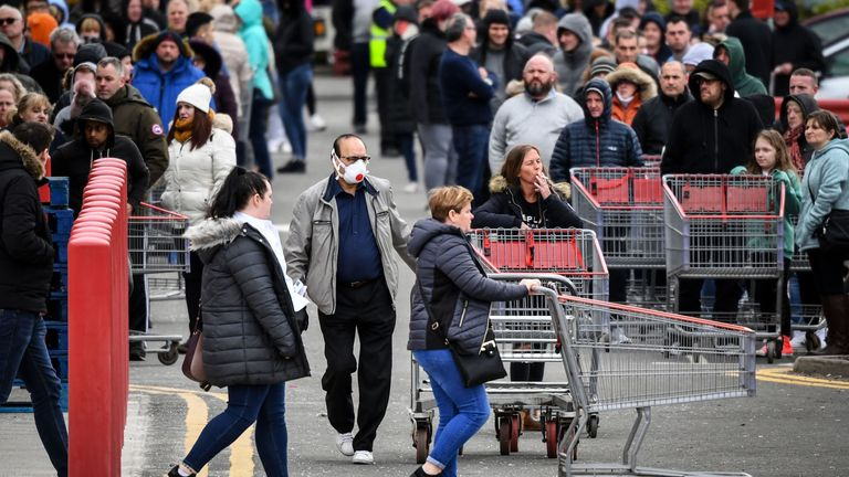 Members of the public queue to get into the Costco store in Glasgow, Scotland before opening on Saturday