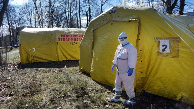 A medical official wearing protective gear stands outside an emergency tent, which was installed for patients infected by the suspected coronavirus infection (COVID-19) near a hospital in Czestochowa, Poland March 11, 2020. Grzegorz Skowronek/Agencja Gazeta via REUTERS ATTENTION EDITORS - THIS IMAGE WAS PROVIDED BY A THIRD PARTY. POLAND OUT. NO COMMERCIAL OR EDITORIAL SALES IN POLAND.