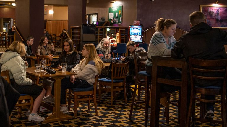 Pub goers enjoy a final evening of drinking in a J.D. Weatherspoon's in London