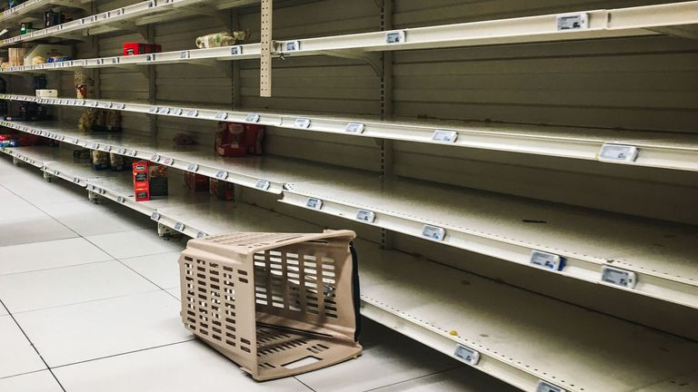 Empty shelves in a supermarket where panic buying has taken place