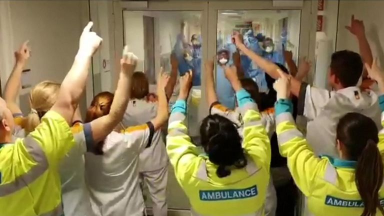 Rotterdam hospital staff show solidarity for coronavirus front line colleagues by singing together through a glass door