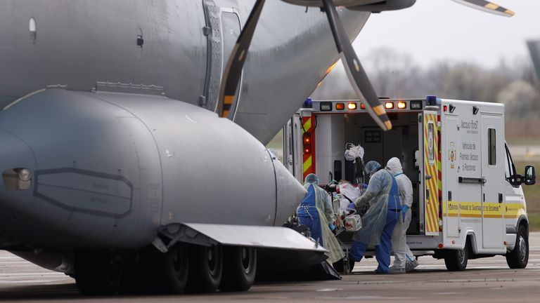Paramedics carrying a patient onto a German military plane in Strasbourg