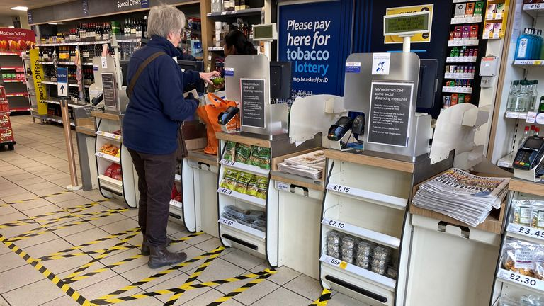 Taped-off areas for customers distance themselves from each other are seen at the checkout